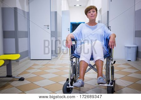 Sad senior patient sitting on a wheelchair in hospital