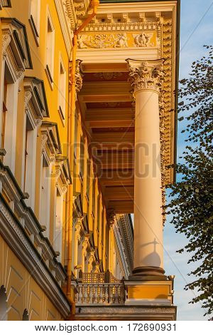 A building facade with corinthian columns in a row (colonnade).  building style