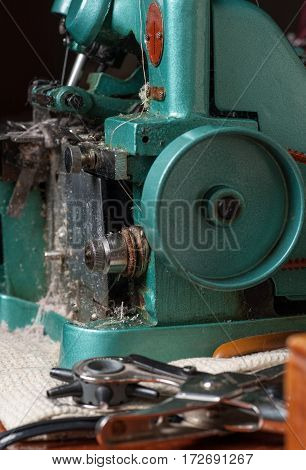 Old Professional edged machine in tailor shop. Selective focus