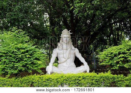 Statue of Hindu Lord Shiva under the tree, Rishikesh, India