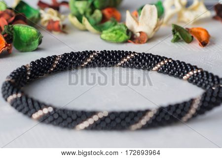 Fragment Of Black And Gold Beaded Necklace Close Up