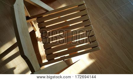 Sun light shine on the wooden chair.