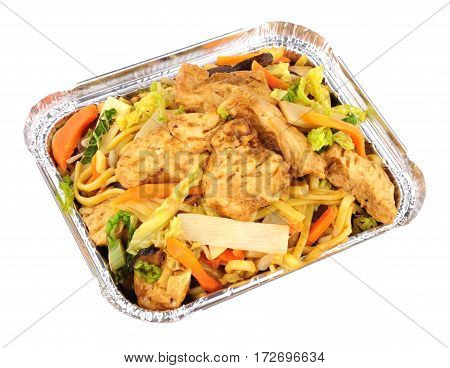 Chinese chicken chow mein take away meal in a foil tray isolated on a white background