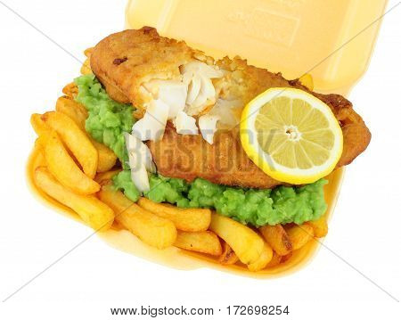 Traditional fish and chips with mushy peas in a take away tray isolated on a white background