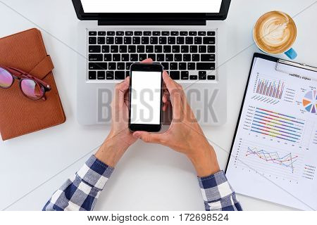 Businessman working with blank screen smart phone and discussing the analysis charts or graphs on modern White office desk table .Business concept.