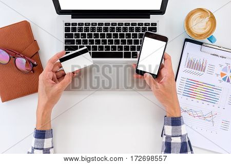 Man hand using blank screen smart phone and credit card for shopping online.Online shopping concept.