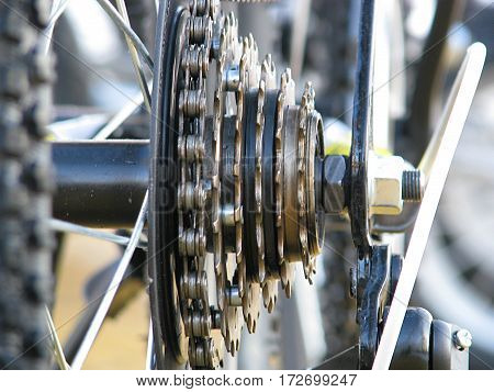 The asterisk and a bicycle chain close-up, switching mechanism
