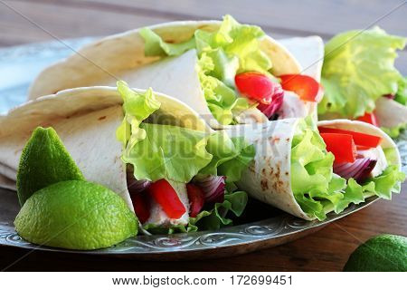 tortilla wraps with grilled chicken and vegetables