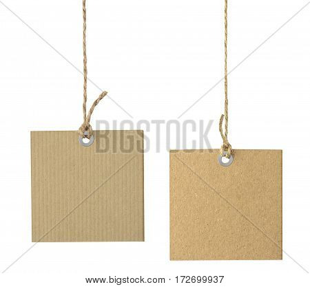 Blank cardboard labels hanging on the rope isolated on white