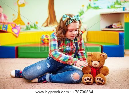 Cute Girl Playing In Kindergarten For Kids With Special Needs