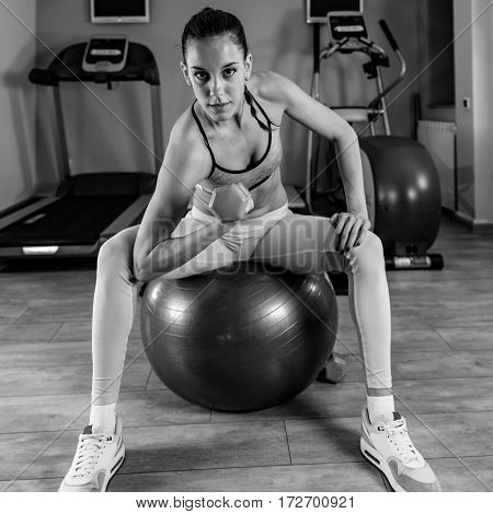Woman Exercising In The Gym On Pilates Ball