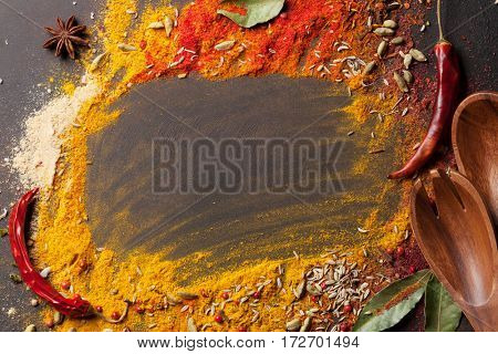 Various spices on stone table. Top view with copy space