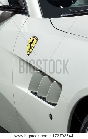 GENEVA, SWITZERLAND: CIRCA 2016:  Abstract front shot of a Ferrari, showing the horse emblem and side intake