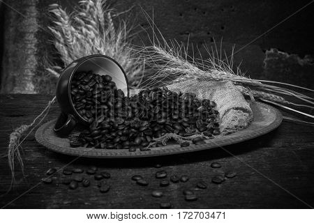roasted coffee bean purifying from coffee cup in still life style