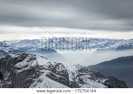 A stormy, wintery mountainscape. Could be used to show winter adventure or danger