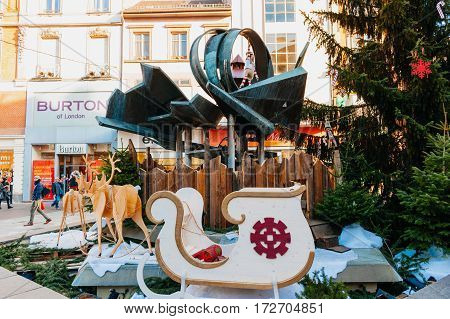 MULHOUSE FRANCE - DEC 12 2015: Traditional street decoration with Chritmas theme in the central Mulhouse France on a busy shopping street