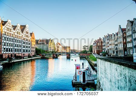 Gdansk Poland - July 18 2014: Bridge and berth at Waterfront of Motlawa River. Embankment of Gdansk is a tourist attraction for visitors.