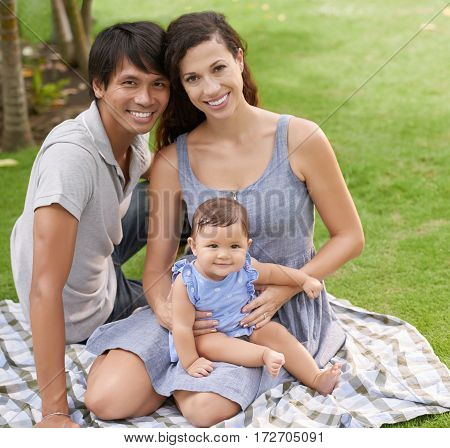 Happy American family having picnic in the park