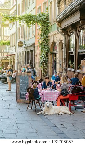 STRASBOURG FRANCE - SEP 12 2015: Families with childrens and pets having lunch at the French restaurant outside tables