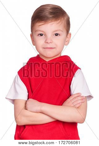 Half-length emotional portrait of caucasian little boy. Funny kid with arms folded, isolated on white background. Handsome child looking at camera.