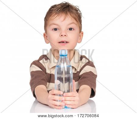 Portrait of cheerful little boy with plastic bottle of water. Cute smiling child having a bottle of refreshing water, isolated on white background.