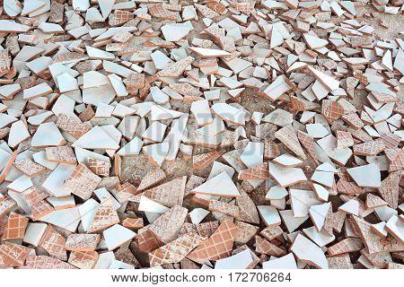 Broken cracked retro tiles floor dirty and broken hydraulic tiles, top view
