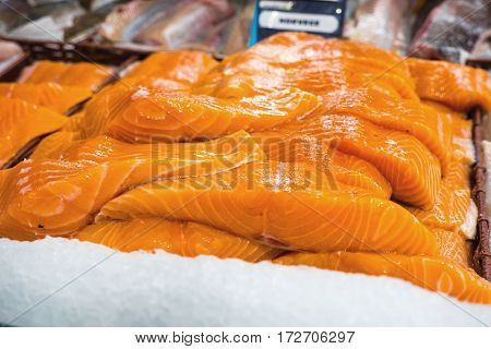 Raw salmon filet on supermarket stall - fresh nordic fish