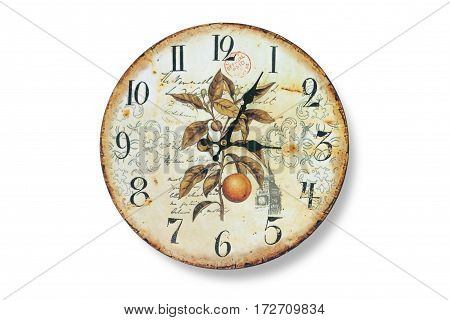 Old wall clock with fading and rust isolated on white background. The dial of the watch with a collage of plants, plant ornament, labels, and silhouettes. Watch with black arrows closeup