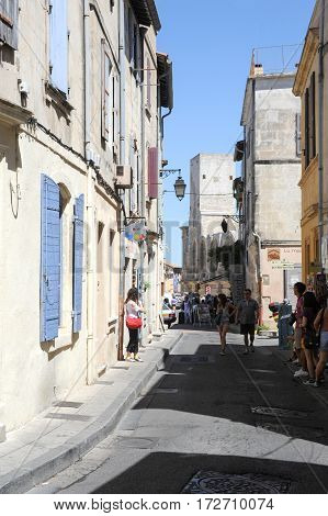 Tourists Walking In The Narrow Streets Of Arles