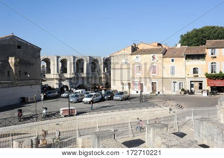 People Walking In Front Of The Amphithater At Arles