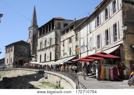 Tourists Walking And Shopping On The Shops Of Arles