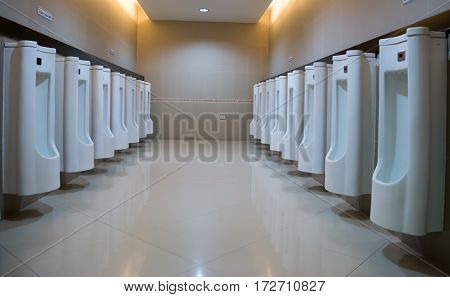 white urinals ceramic in men's bathroom, bathroom for man