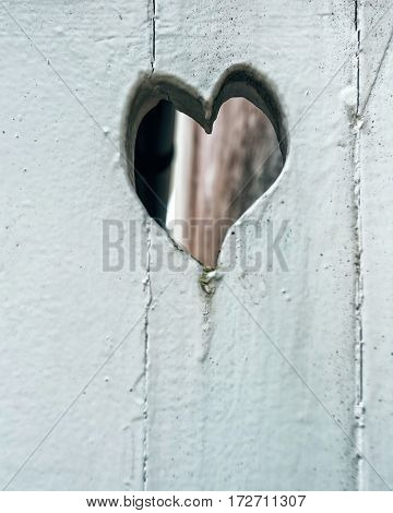 Old white wooden door with heart close up