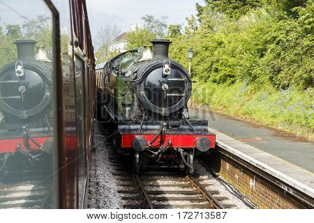 Steam train waiting at Churston Station in Devon, peart of the Dartmouth Steam Railway