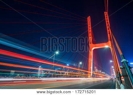 traffic on bridge at night in Nanchang city, China.