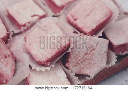 Rose turkish delight, rahat lokum. Tray with eastern sweets closeup poster