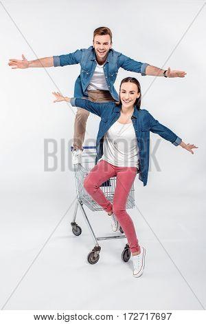 Cheerful Couple Having Fun On Shopping Cart
