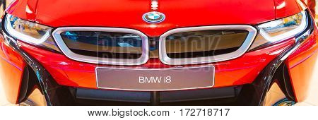 Munich, Germany - December 28, 2016: Red BMW i8 logo car front view banner background