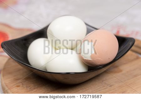 Boiled And Pealed Eggs Served On The Black Plate