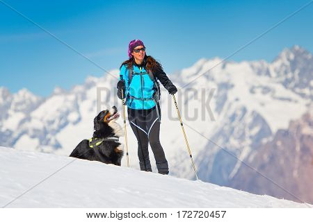 Alpinist Girl On Skis And Sealskins Alone With His Dog Faithful Friend