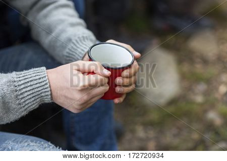 Man Holding Coffee Cup At Campsite