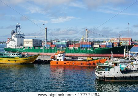 Labuan,Malaysia-Feb 22,2017:Container cargo ship heading for Labuan port in Labuan,Malaysia.Its a sheltered deep water harbour which is an important transshipment point for Brunei,Sarawak & Sabah,Borneo.