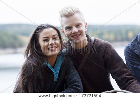 Smiling Multiethnic Couple At Lakeside Camping