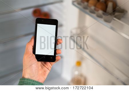 Person Hands Holding Smartphone With White Screen