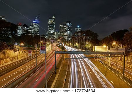 Urban highway at night with blurred traffic