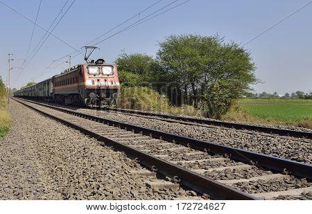 Indian Long Distance Train Approaching Station Near Mumbai