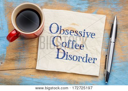 Obsessive coffee disorder (OCD) - handwriting  on a napkin with a cup of coffee