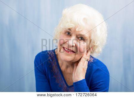 Portrait of beautiful grandma smiling at the camera