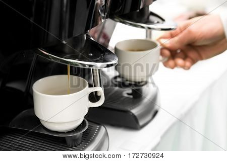 Detail Of Two Espresso Coffee Machines Making Coffee.