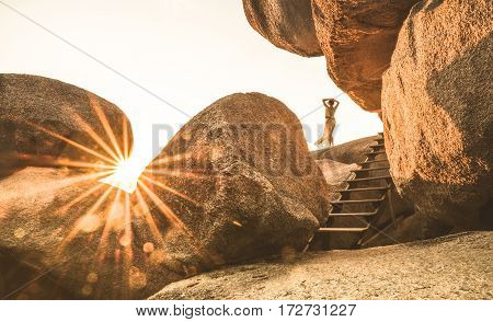 Young woman traveler enjoying peaceful sunset on Sailing Rock on Similan Islands - Wanderlust travel concept with adventure girl tourist wanderer on solo excursion in Thailand - Warm bright filter